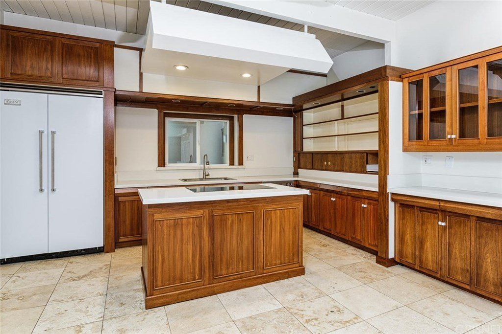 A look at the original kitchen.  Photo 13 of 25 in Before & After: Two Brothers List Their Swanky Midcentury Bachelor Pad for $1.6M