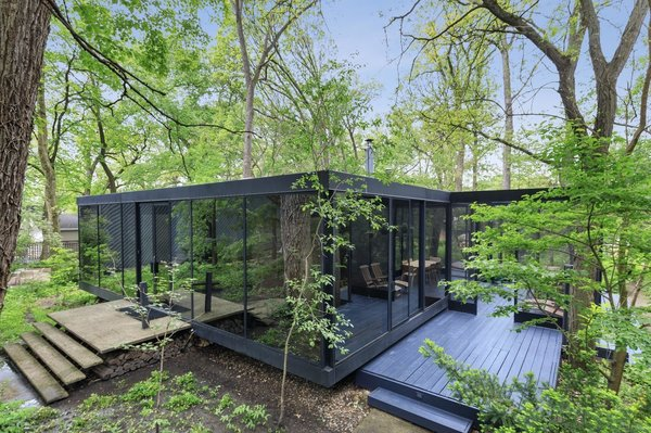 Originally the home of a local architect, this steel-and-glass home is now up for sale in Downers Grove, Illinois. The structure is sited toward the back of a mostly wooded .34-acre lot, with a dense section of trees providing additional privacy from the street.