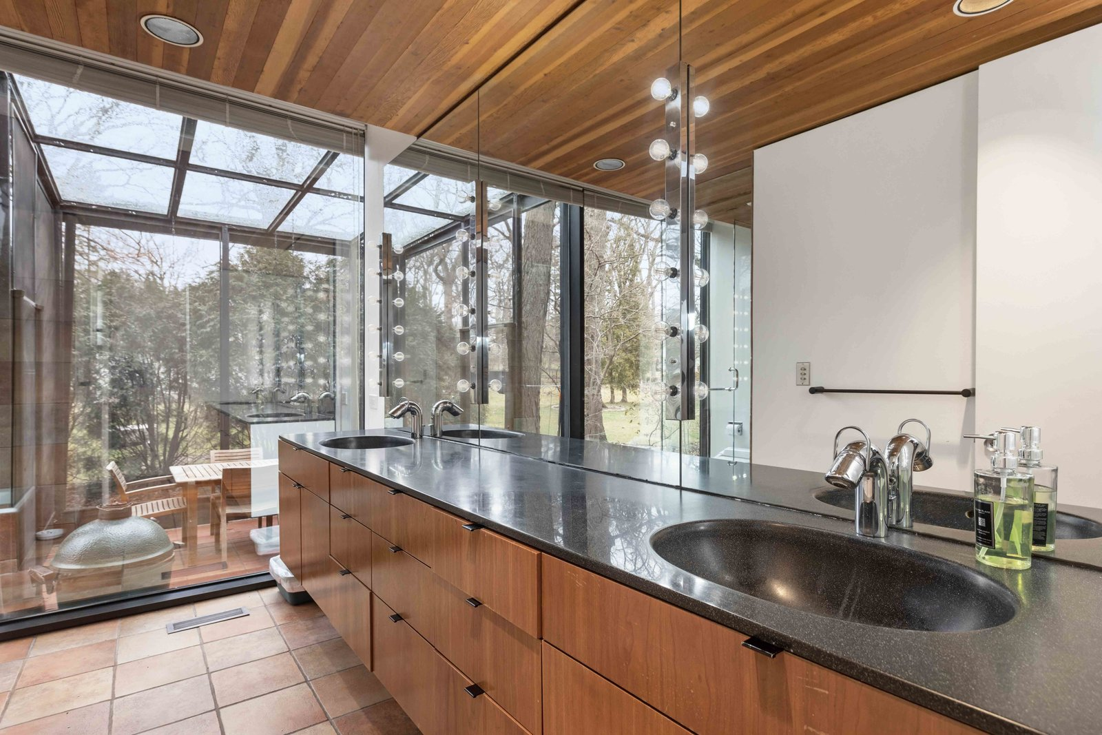 Another view of the bathroom.  Photo 10 of 15 in A Blackened Steel and Glass House Outside of Chicago Hits the Market for $825K