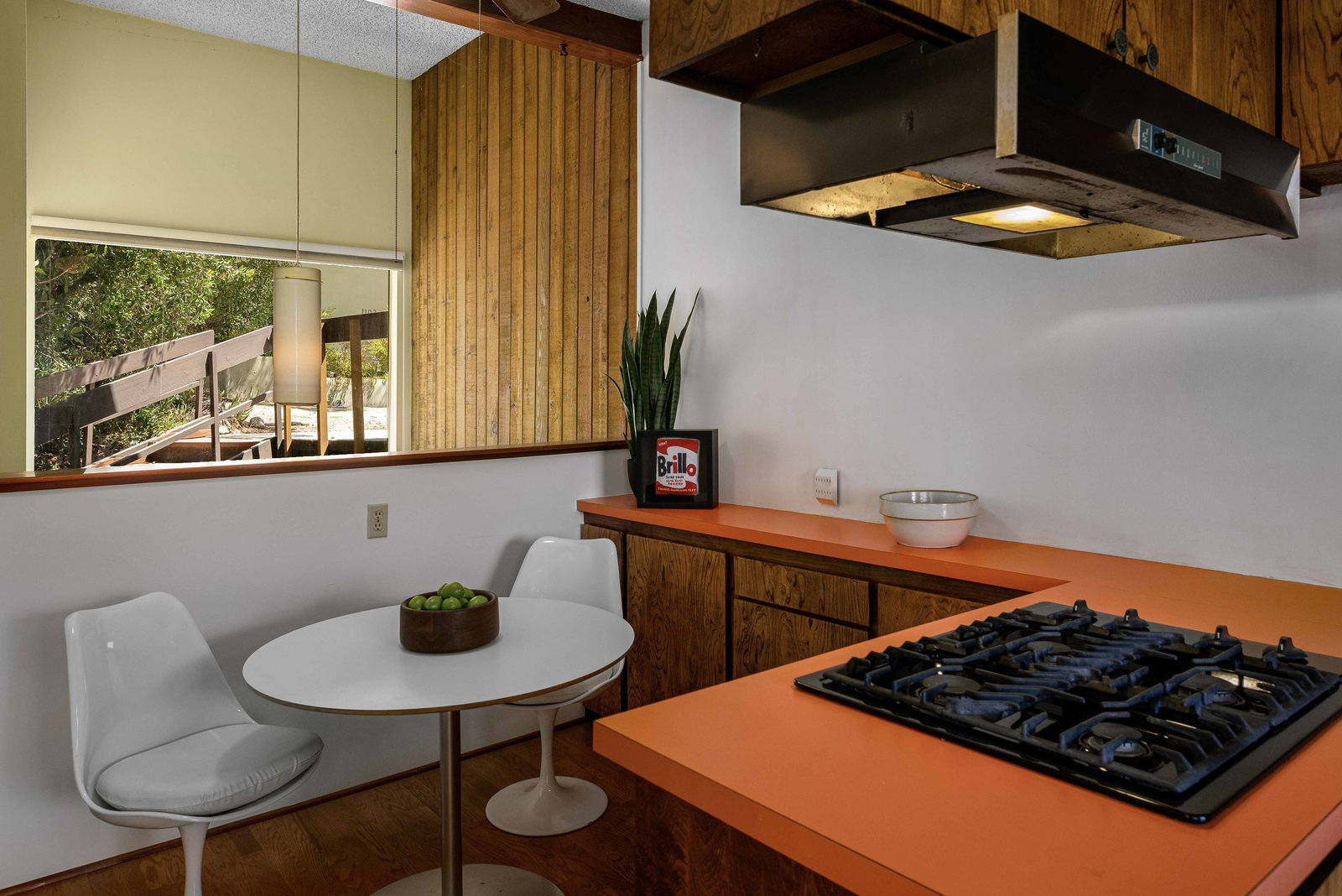 """A small breakfast area is located in another corner of the kitchen.  Photo 8 of 15 in This $1.2M California Midcentury House Looks Like It Came Straight Out of """"Mad Men"""""""