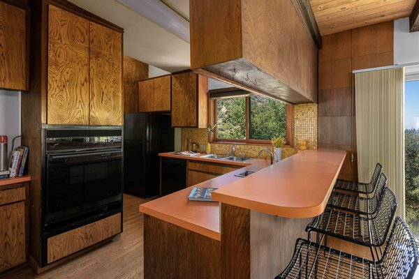 The kitchen features original cabinetry and formica countertops.