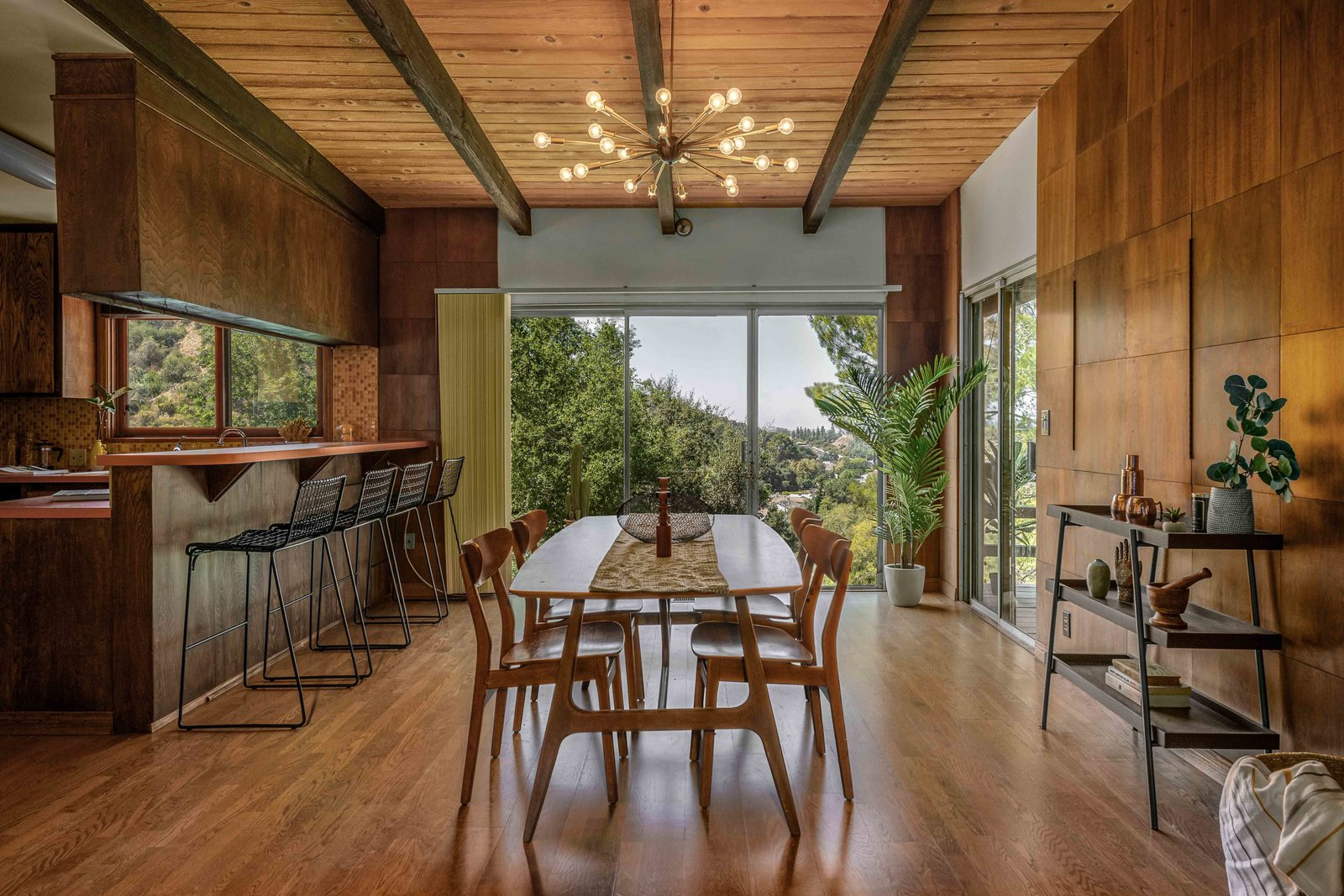 """Back inside, the formal dining area is located next to the kitchen. The current owners replaced some of the hardwood floors throughout this level.  Photo 5 of 15 in This $1.2M California Midcentury House Looks Like It Came Straight Out of """"Mad Men"""""""