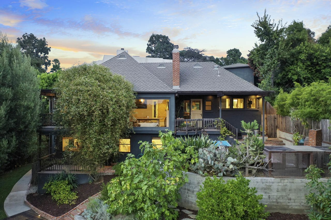 The two-level home follows the sloping lot with multiple patios, decks, and porches to enjoy the outdoors.  Photo 24 of 24 in Asking $3.75M, This Bohemian Hillside Home in L.A. Comes Complete With a Potter's Studio