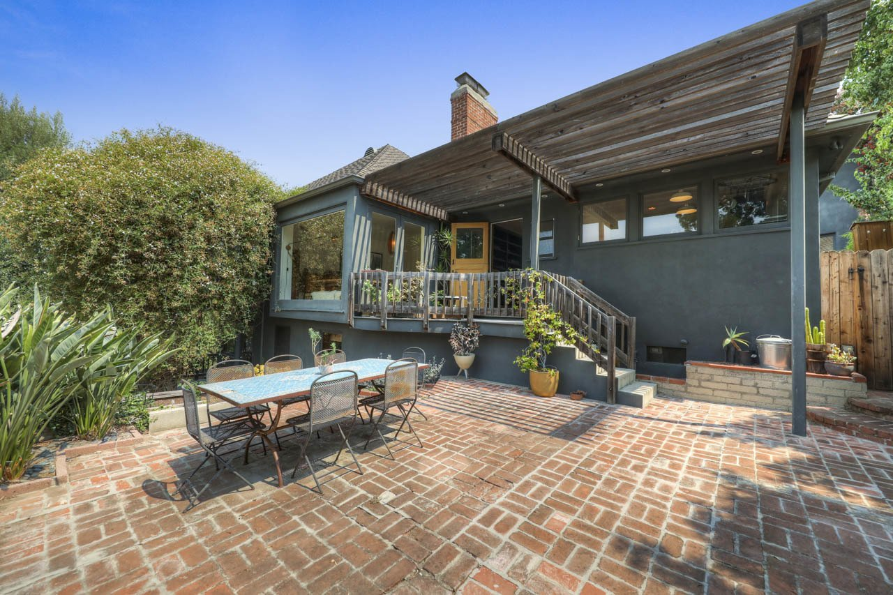 A rear patio is accessible from the living room and kitchen.  Photo 17 of 24 in Asking $3.75M, This Bohemian Hillside Home in L.A. Comes Complete With a Potter's Studio