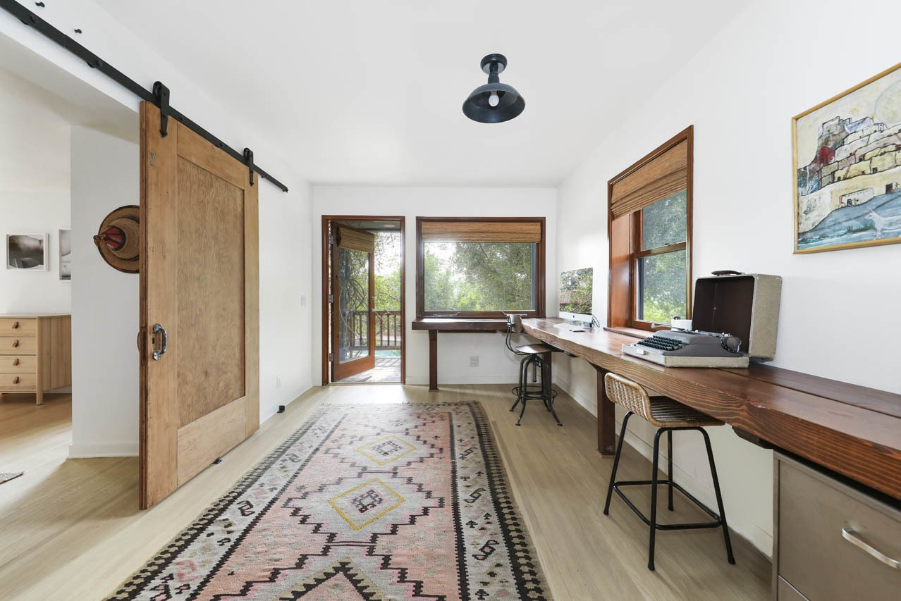 Pieces of timber run along a wall to create an expansive work area in the office.  Photo 15 of 24 in Asking $3.75M, This Bohemian Hillside Home in L.A. Comes Complete With a Potter's Studio