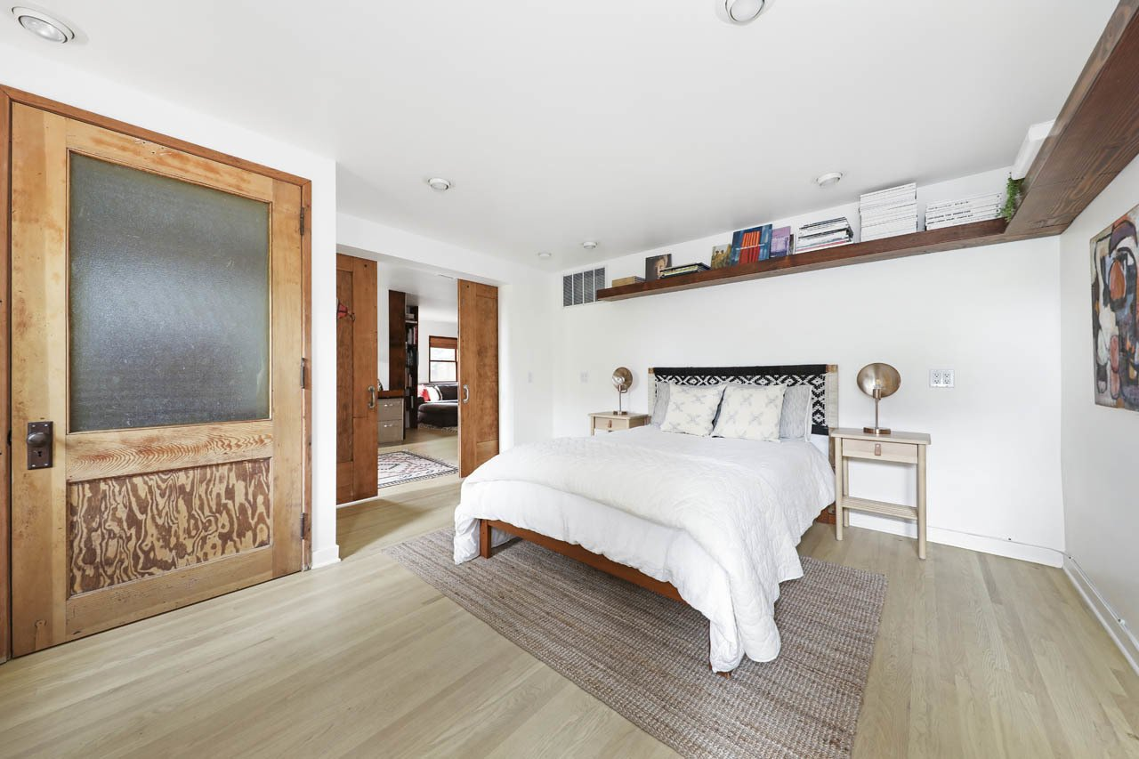A look at the third bedroom downstairs.  Photo 13 of 24 in Asking $3.75M, This Bohemian Hillside Home in L.A. Comes Complete With a Potter's Studio