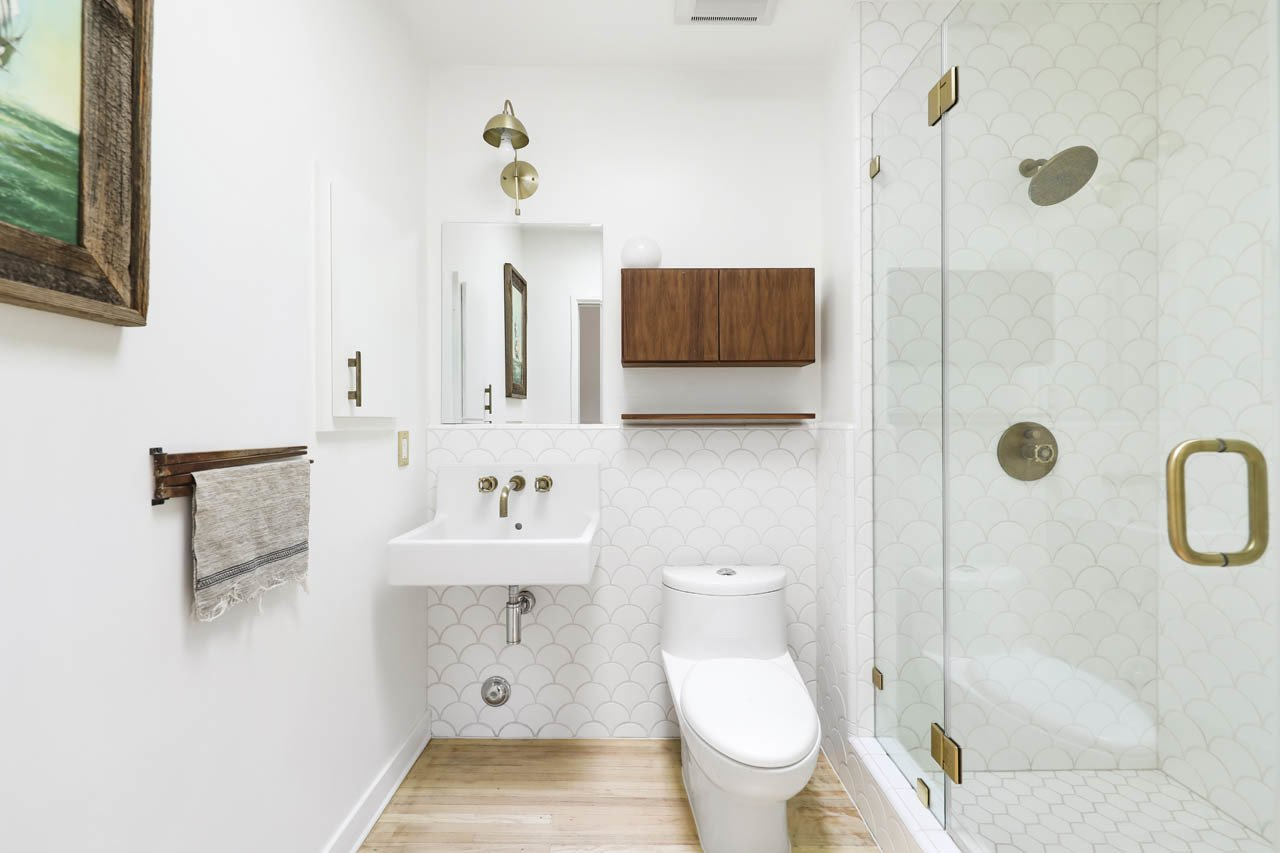 A full bathroom is located across the hall.  Photo 12 of 24 in Asking $3.75M, This Bohemian Hillside Home in L.A. Comes Complete With a Potter's Studio