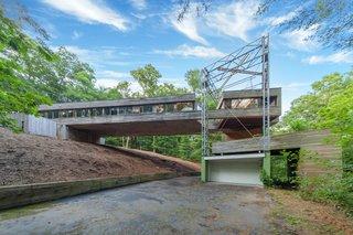 A Bridge-Like Home Suspended Above a Connecticut Hillside Asks $530K