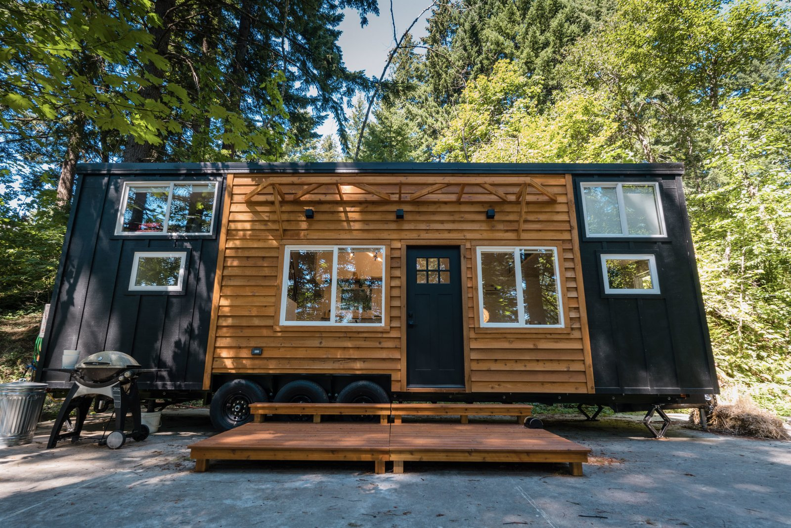 Outside, a pair of moveable six-foot-square cedar decks also come with the sale and can be packed inside of the home for traveling. LED lights, various hookups, and an outdoor shower round out the exterior features.  Photo 11 of 11 in A Furnished Tiny Home With Japanese and Scandinavian Vibes Is Offered at $99K