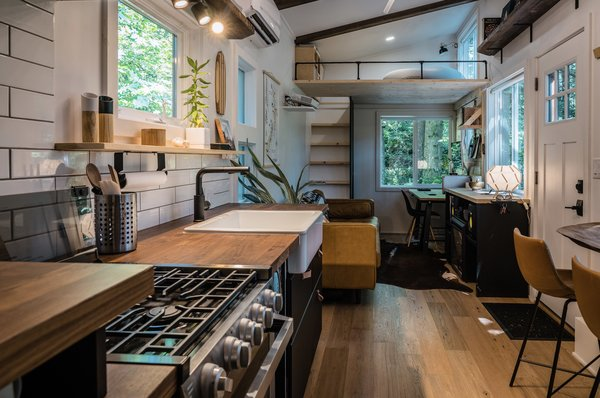 The kitchen also comes with a 21-inch propane stove and oven, as well as a two-door fridge/freezer unit tucked into a cubby along the opposite wall (not pictured).
