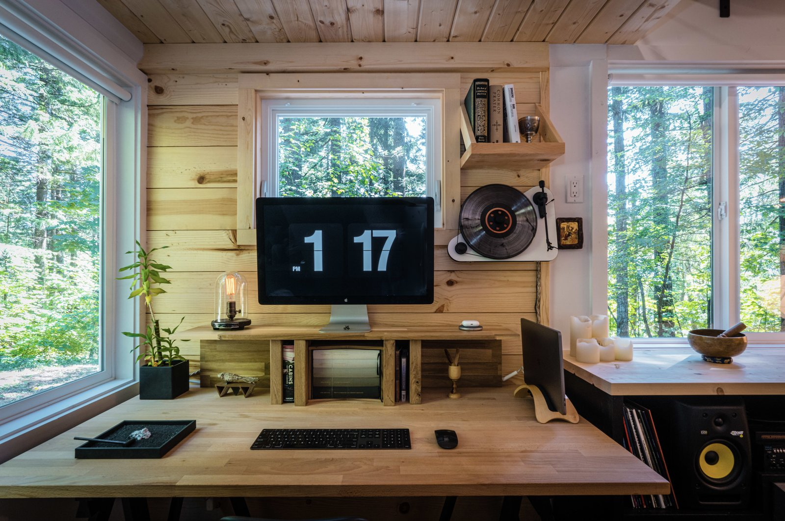 "In a sunlit corner, a wooden desktop sits on black trestles from IKEA. ""I first created the desk setup to mimic the mug and teapot, which Stelton describes it as 'Scandinavia meets Japan,'"" explains Stephen. ""Similarly, the overall design [of the tiny home] intended to honor the spirit of Japanese tea culture while incorporating the style of Nordic minimalism.""  Photo 3 of 11 in A Furnished Tiny Home With Japanese and Scandinavian Vibes Is Offered at $99K"