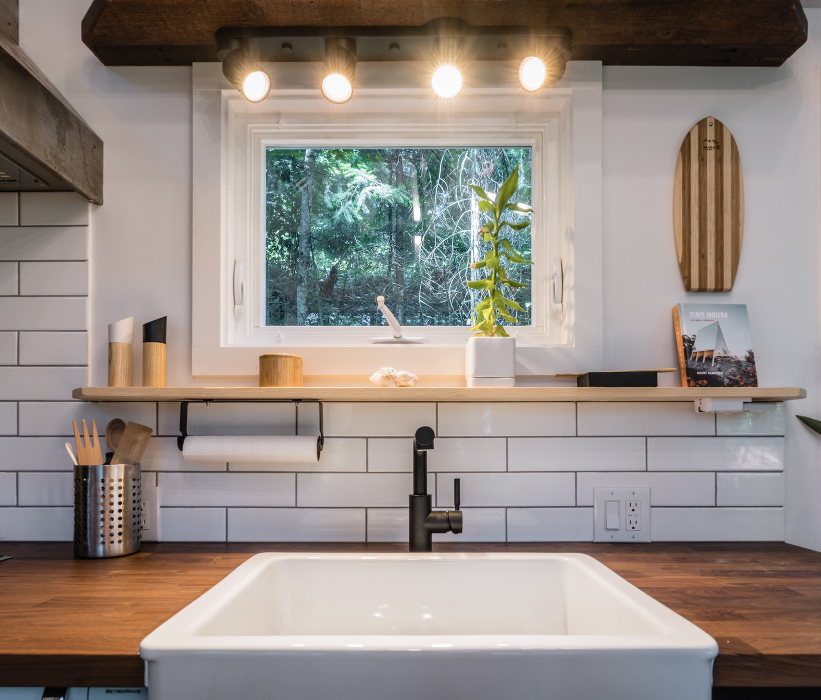 A small window above the kitchen sink looks out at the surroundings.  Photo 6 of 11 in A Furnished Tiny Home With Japanese and Scandinavian Vibes Is Offered at $99K