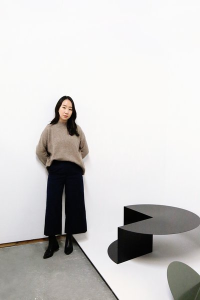 Detroit–based designer Nina Cho with her Cantilever Coffee Table