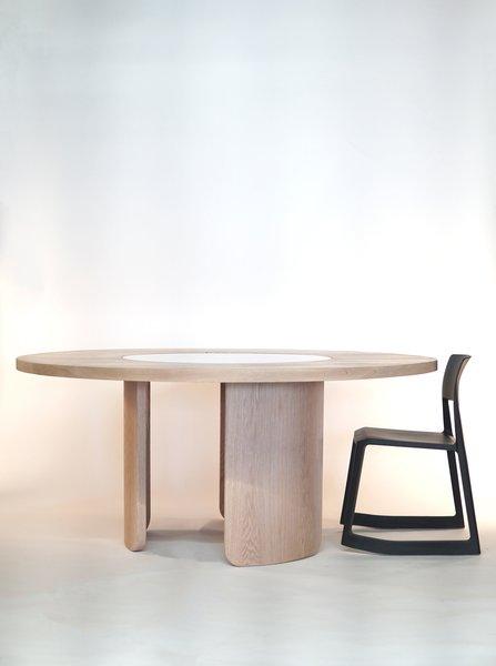 The Around About circular dining table by Ko Júbilo