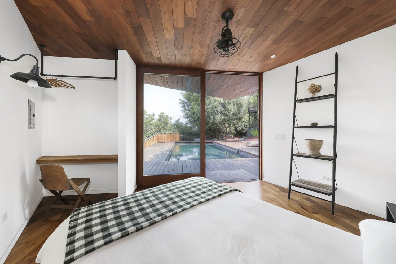Inside, the guesthouse features wood-clad ceilings and offers a full bathroom.  Photo 22 of 24 in Asking $3.75M, This Bohemian Hillside Home in L.A. Comes Complete With a Potter's Studio