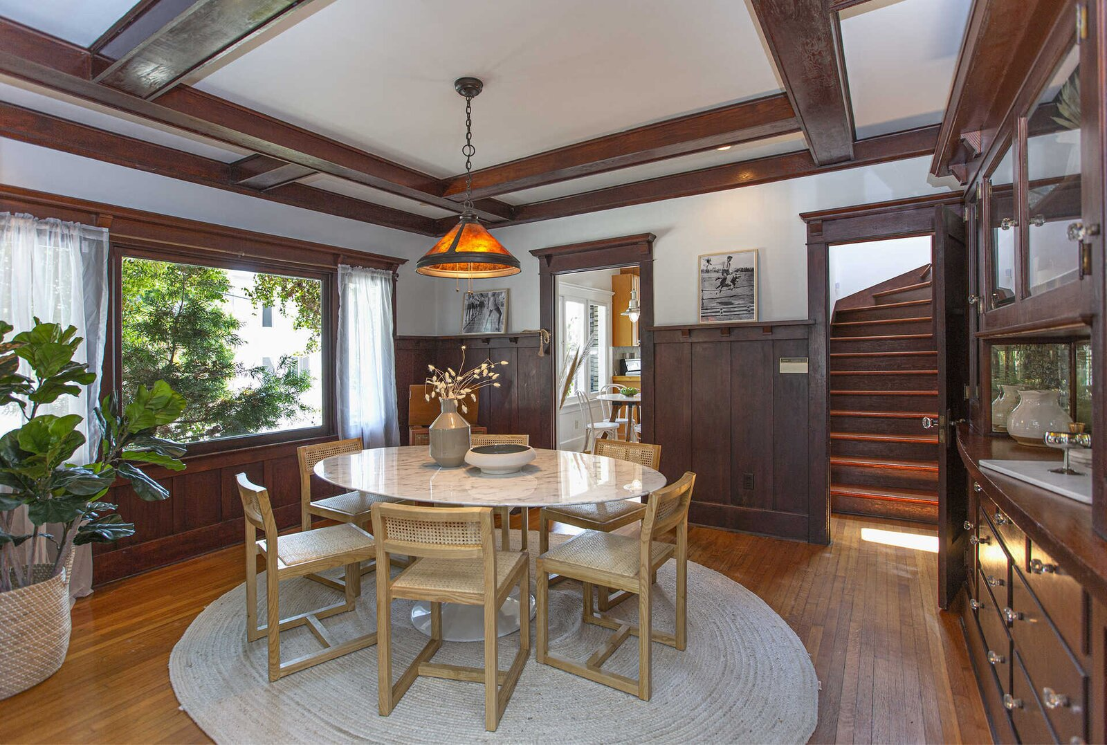 """The dining area offers continues with Craftsman-style features—including a built-in china cabinet and wainscoting. Forte and his colleagues often spent time in the space writing scrips for the movie, MacGruber, and TV series, <span style=""""font-family: Theinhardt, -apple-system, BlinkMacSystemFont, &quot;Segoe UI&quot;, Roboto, Oxygen-Sans, Ubuntu, Cantarell, &quot;Helvetica Neue&quot;, sans-serif;"""">The Last Man on Earth.</span>  Photo 5 of 14 in """"Last Man on Earth"""" Creator Will Forte Puts His Santa Monica Craftsman on the Market for $2.45M"""