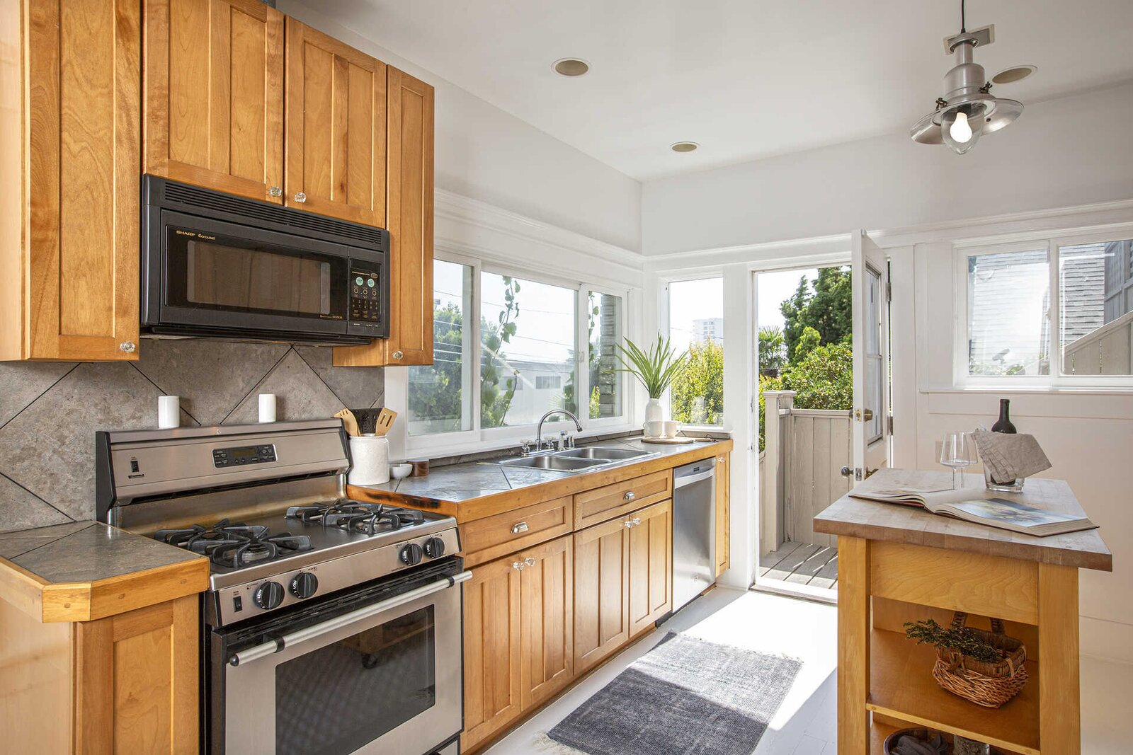 """The kitchen also provides direct access to a rooftop deck above the garage.  Photo 7 of 14 in """"Last Man on Earth"""" Creator Will Forte Puts His Santa Monica Craftsman on the Market for $2.45M"""