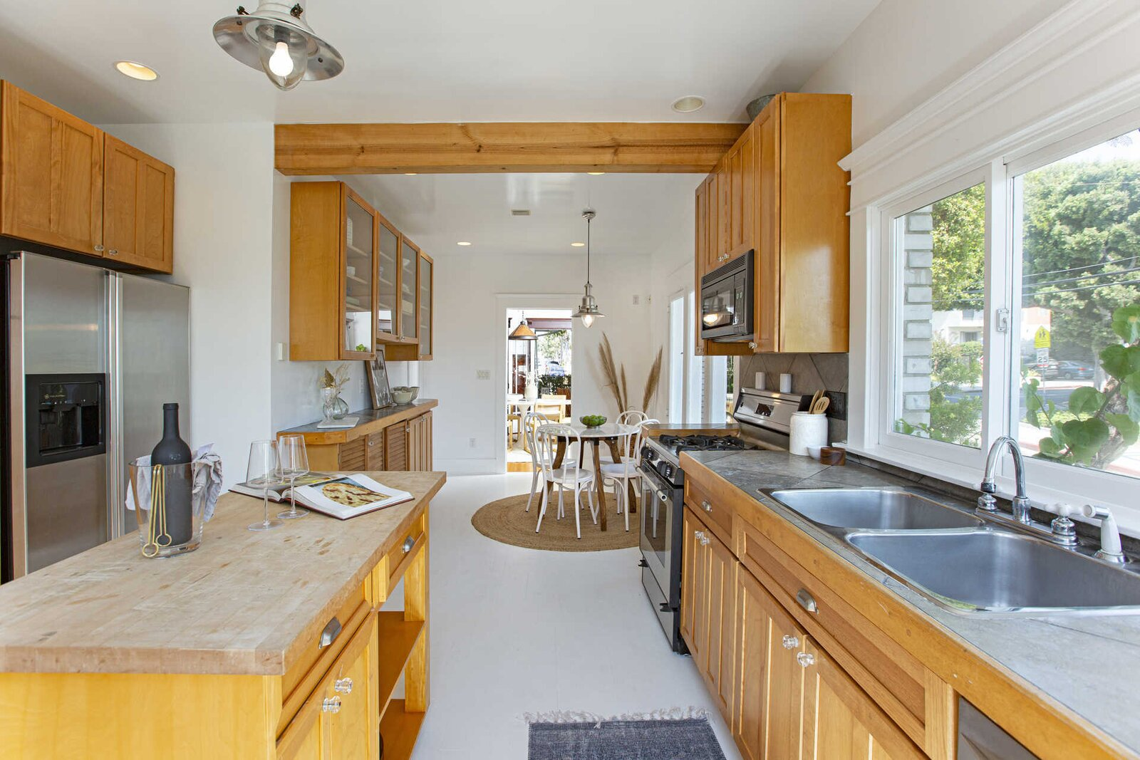 """At the rear of the home, a modern kitchen offers ample cabinetry and a second dining area.  Photo 6 of 14 in """"Last Man on Earth"""" Creator Will Forte Puts His Santa Monica Craftsman on the Market for $2.45M"""