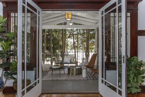 French doors in the living area lead out to a cozy outdoor space.