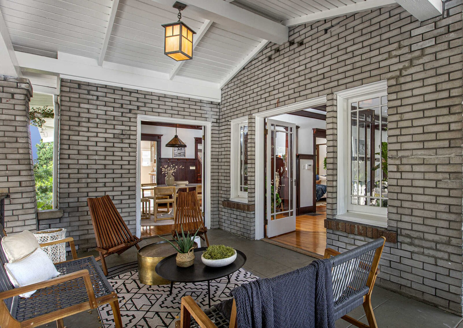 """The outdoor space is part of the wrap-around front porch and is also accessible from the formal dining room.  Photo 4 of 14 in """"Last Man on Earth"""" Creator Will Forte Puts His Santa Monica Craftsman on the Market for $2.45M"""