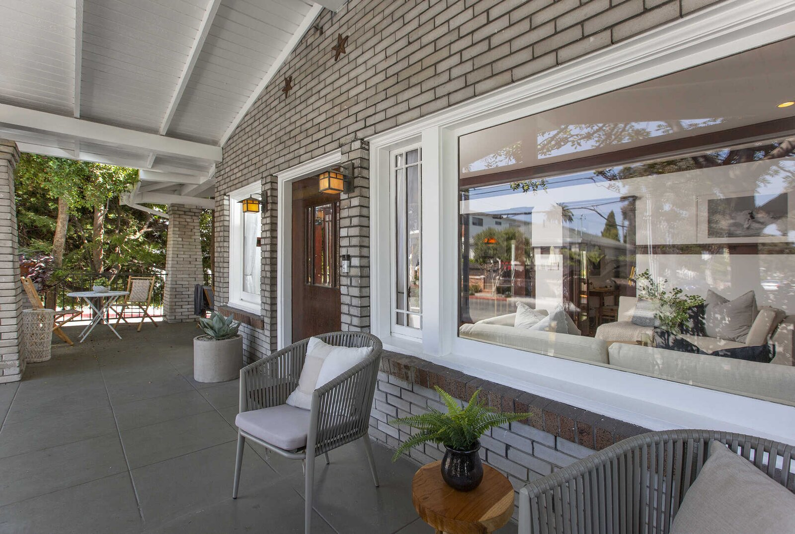 "Outside, the classic Craftsman porch provides a large, covered outdoor area along the front of the home.  Photo 13 of 14 in ""Last Man on Earth"" Creator Will Forte Puts His Santa Monica Craftsman on the Market for $2.45M"