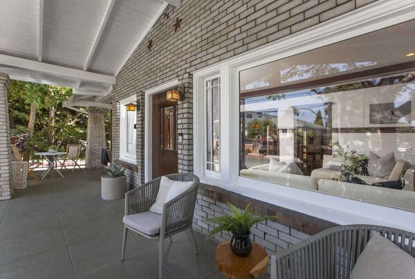 Outside, the classic Craftsman porch provides a large, covered outdoor area along the front of the home.