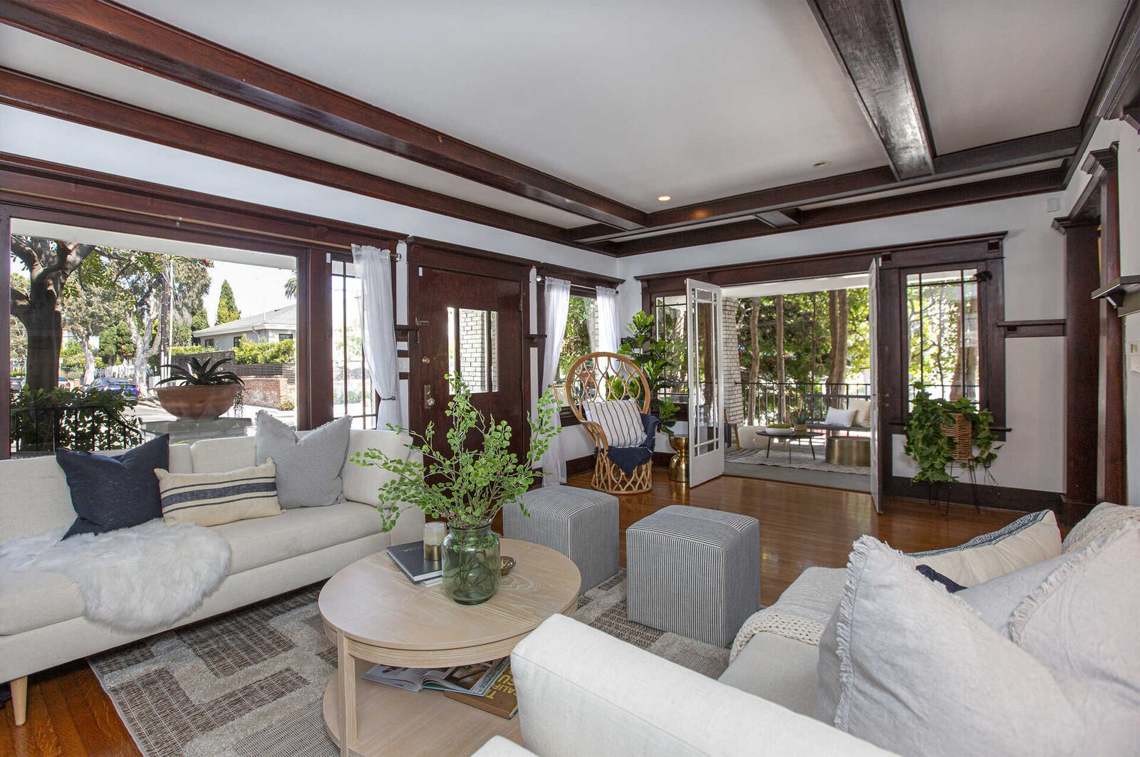 """Inside, the front door opens into a large living area that runs along the front of the home. Traditional Craftsman features abound in the space—most notably the original beamed ceilings and extensive moldings.  Photo 2 of 14 in """"Last Man on Earth"""" Creator Will Forte Puts His Santa Monica Craftsman on the Market for $2.45M"""