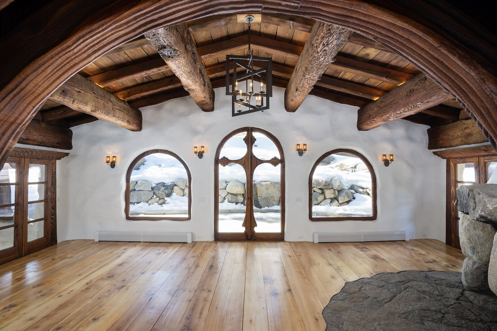 "Inside, hand-carved wooden details abound—including <span style=""font-family: Theinhardt, -apple-system, BlinkMacSystemFont, &quot;Segoe UI&quot;, Roboto, Oxygen-Sans, Ubuntu, Cantarell, &quot;Helvetica Neue&quot;, sans-serif;"">massive timber beams brought in from Oregon and milled on site during the home's original construction. Other details include </span>  Photo 2 of 15 in Listed for $2.65M, This Bavarian-Style ""Snow Haus"" Near Lake Tahoe Is the Perfect Alpine Escape"