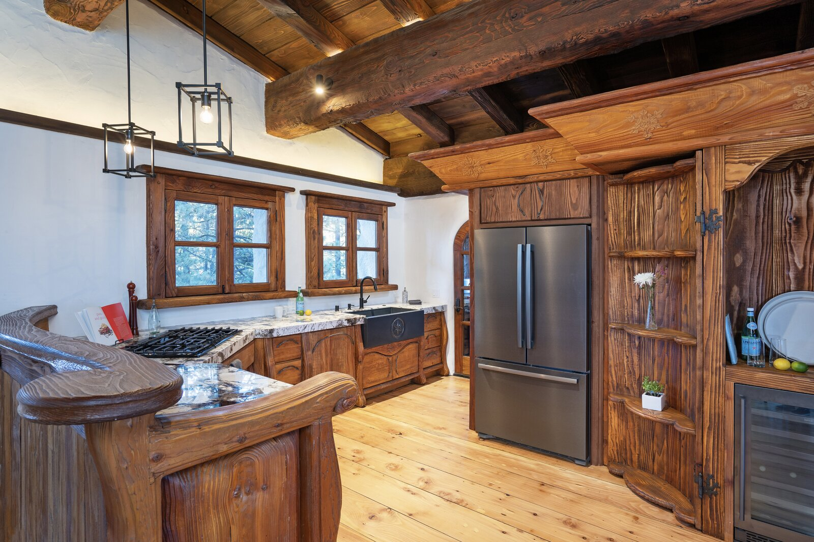 "The kitchen cabinetry comes with carved details and custom hardware.  Photo 5 of 15 in Listed for $2.65M, This Bavarian-Style ""Snow Haus"" Near Lake Tahoe Is the Perfect Alpine Escape"