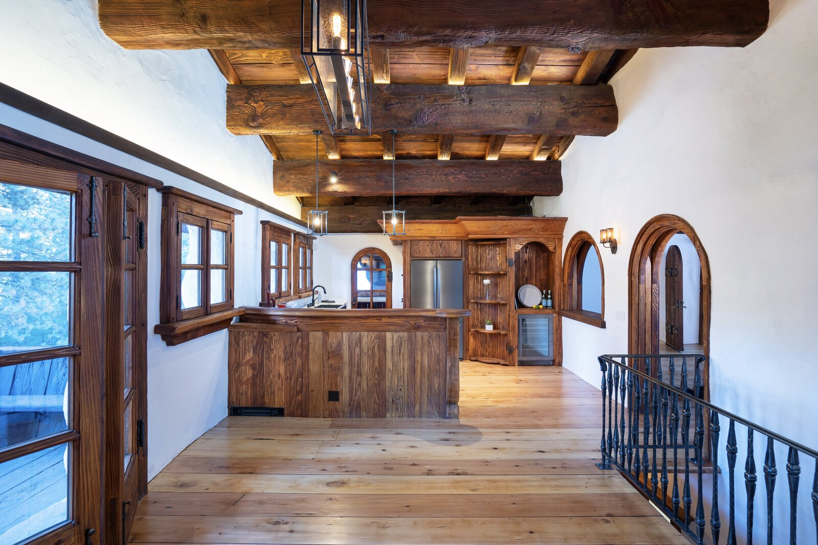 "Opposite the living area, the kitchen opens into a large dining area/family room. Many of the same details extend into this space, which also features French doors leading to the front deck.  Photo 4 of 15 in Listed for $2.65M, This Bavarian-Style ""Snow Haus"" Near Lake Tahoe Is the Perfect Alpine Escape"