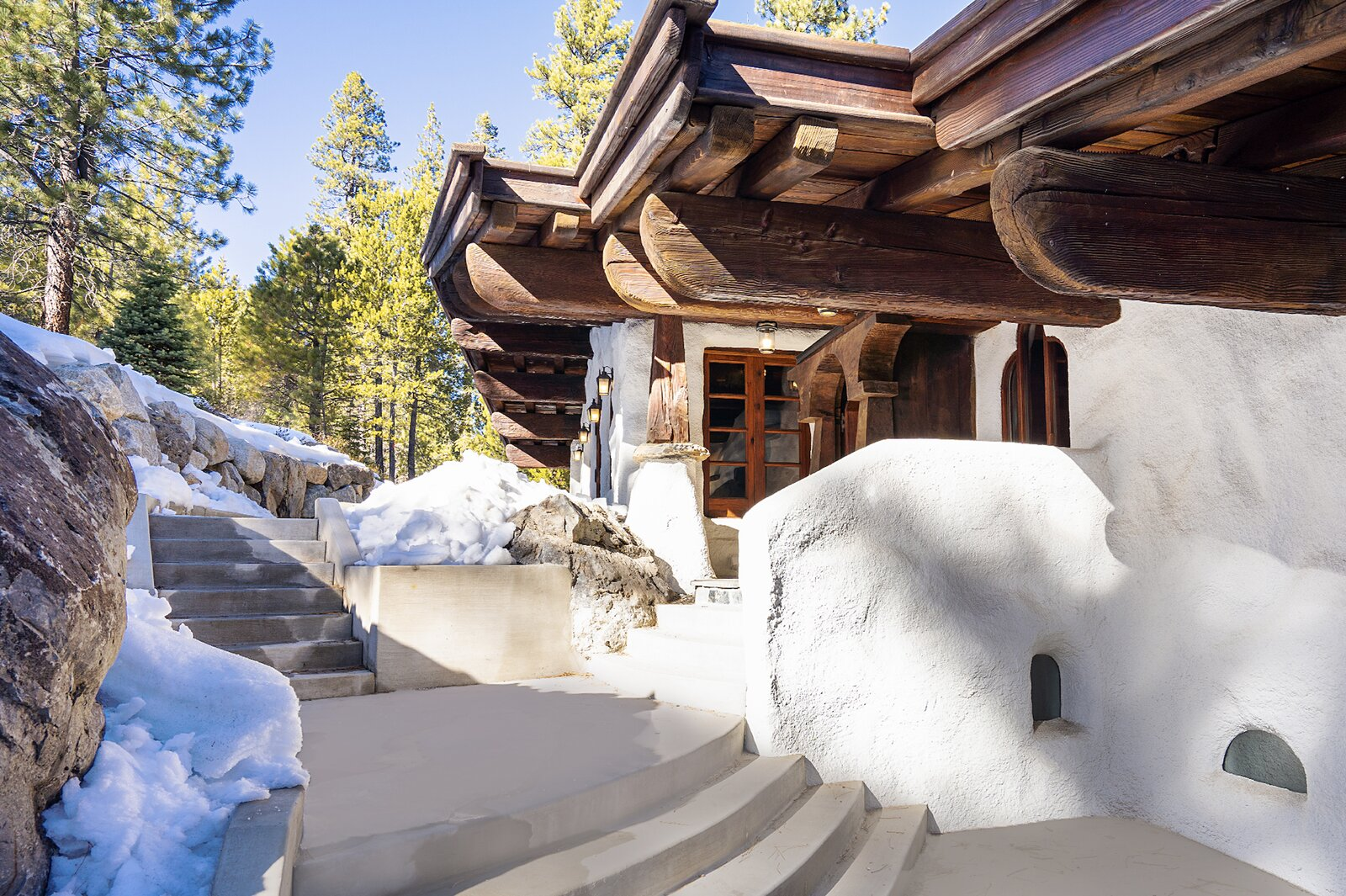 """Walkways around the home connect several patios and outdoor areas.  Photo 13 of 15 in Listed for $2.65M, This Bavarian-Style """"Snow Haus"""" Near Lake Tahoe Is the Perfect Alpine Escape"""