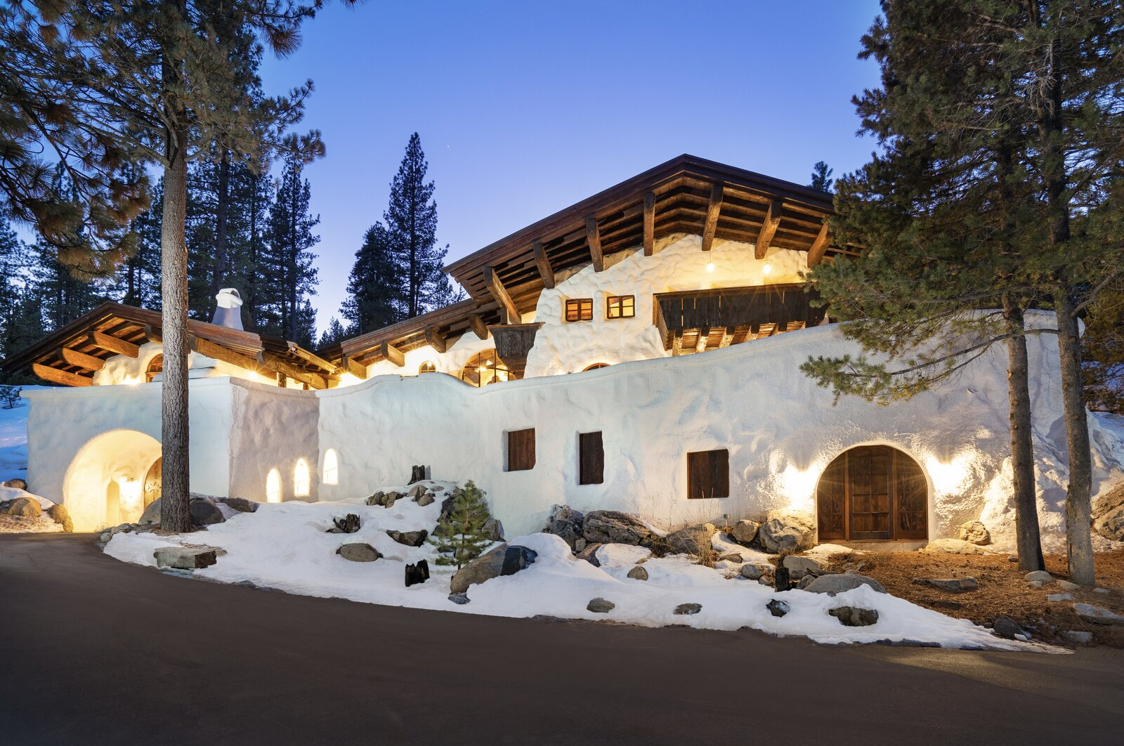 """The facade is illuminated at night by numerous lights along the exterior.  Photo 15 of 15 in Listed for $2.65M, This Bavarian-Style """"Snow Haus"""" Near Lake Tahoe Is the Perfect Alpine Escape"""