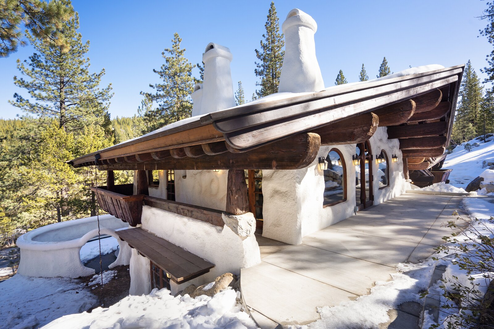 "Among the outdoor spaces are a large patio off of the living area and a massive sunken fire pit— shown here at the bottom corner of the home.  Photo 14 of 15 in Listed for $2.65M, This Bavarian-Style ""Snow Haus"" Near Lake Tahoe Is the Perfect Alpine Escape"