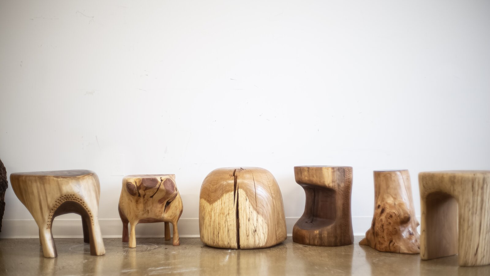Love's hand-carved stools are all unique and each one is made from a singular piece of wood  Photo 9 of 12 in Designer to Know: Ian Love