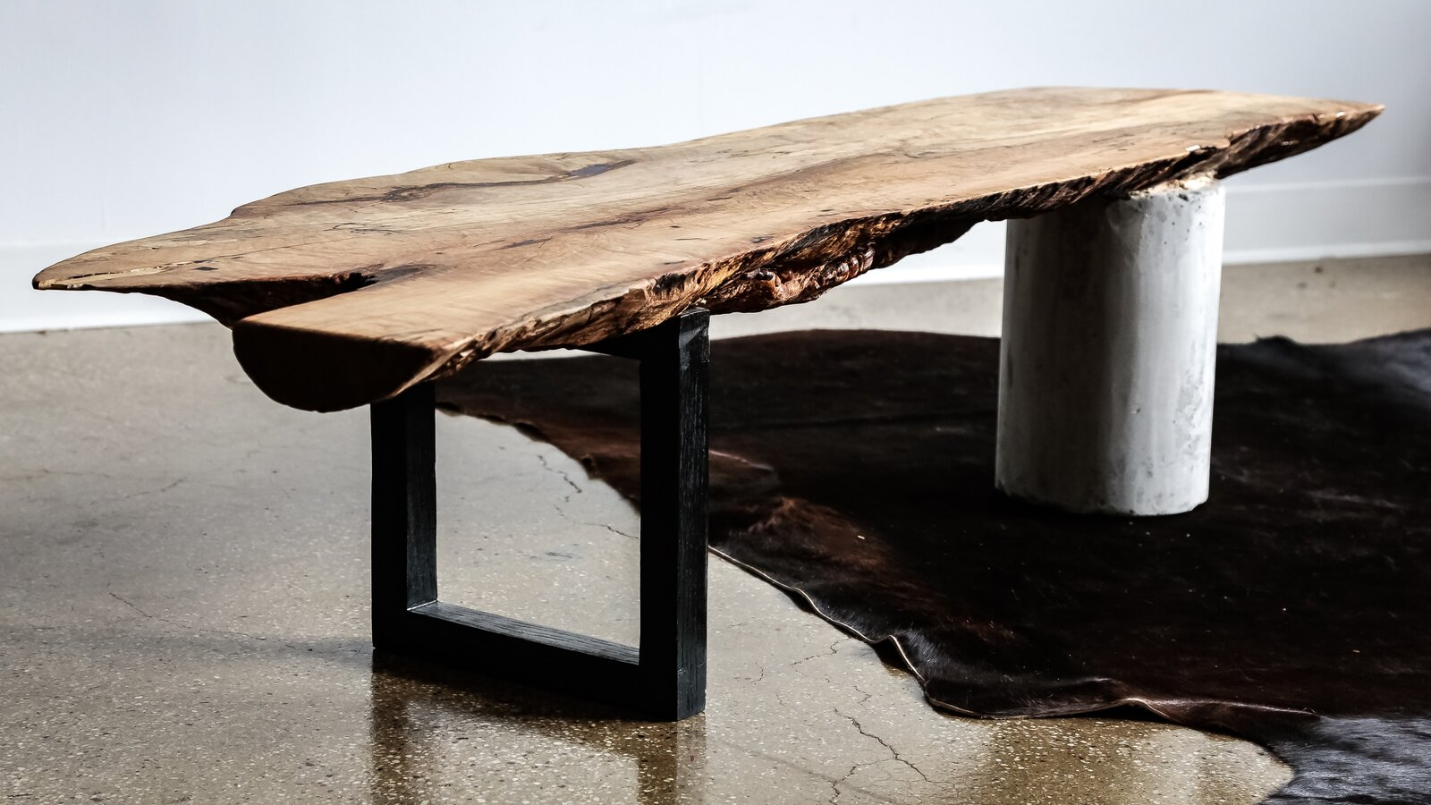 A spalted maple end-cut bench with legs made from ebonized oak and concrete  Photo 5 of 12 in Designer to Know: Ian Love