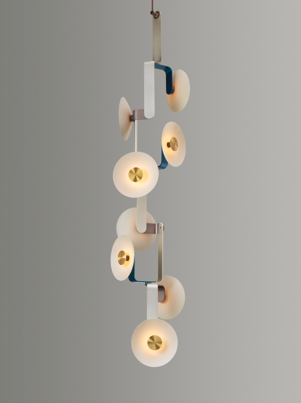 Dieter's elbo collection unites anodized or plated aluminum with porcelain or glass diffusers.  Photo 6 of 9 in Designer to Know: James Dieter