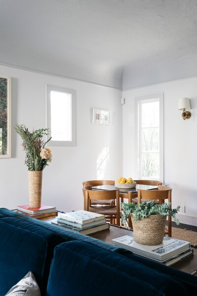 A small dining area is located in one corner of the living room. Throughout the home, the coved ceilings are highlighted by crown molding a subtle color shift.
