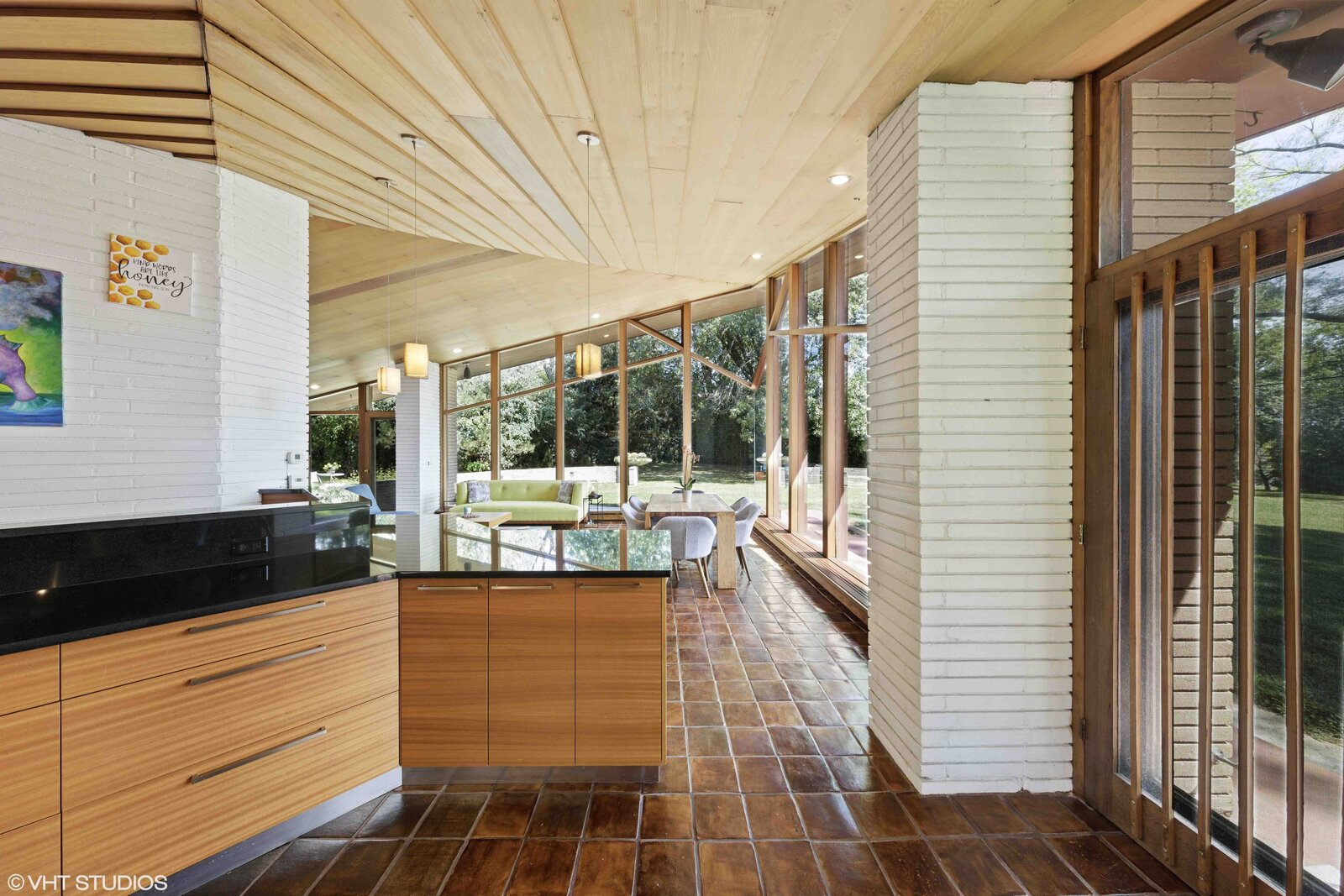 A door in the kitchen also provides access to a large patio.  Photo 7 of 14 in A Big and Bright Midcentury Home by Frank Lloyd Wright Apprentice Don Erickson Asks $595K
