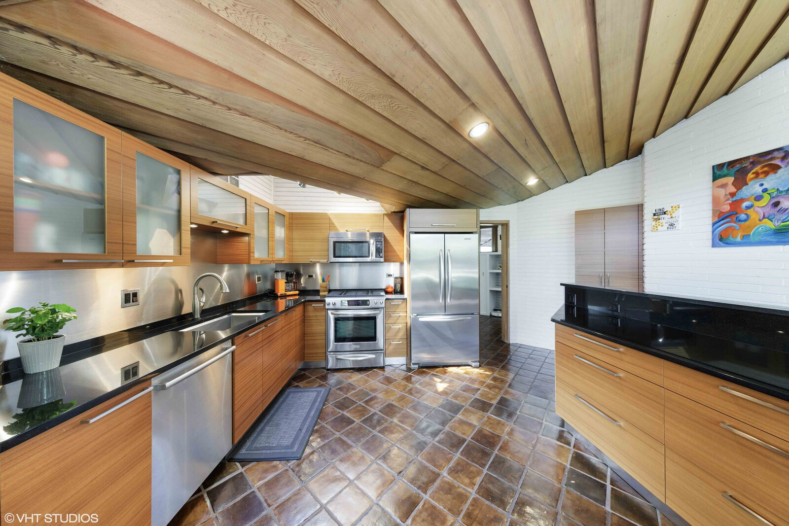 Another triangular skylight hangs over a corner of the kitchen.  Photo 6 of 14 in A Big and Bright Midcentury Home by Frank Lloyd Wright Apprentice Don Erickson Asks $595K