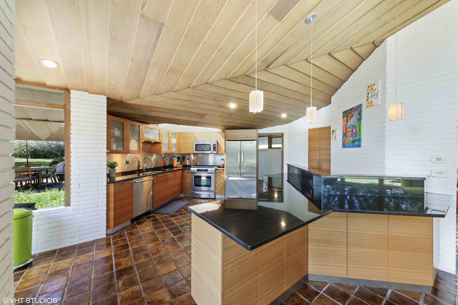Behind the dining area is a modern kitchen, recently renovated with all new cabinetry, appliances, and finishes.  Photo 5 of 14 in A Big and Bright Midcentury Home by Frank Lloyd Wright Apprentice Don Erickson Asks $595K