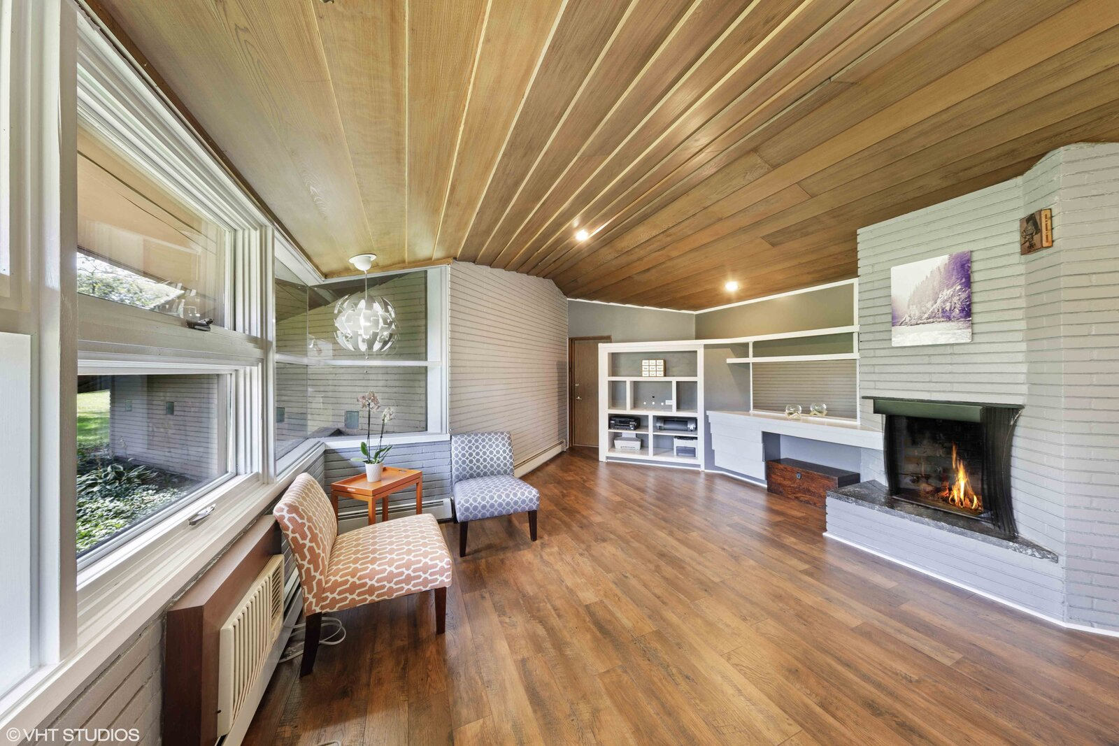 The second principal suite is currently set up as a home office.  Photo 11 of 14 in A Big and Bright Midcentury Home by Frank Lloyd Wright Apprentice Don Erickson Asks $595K