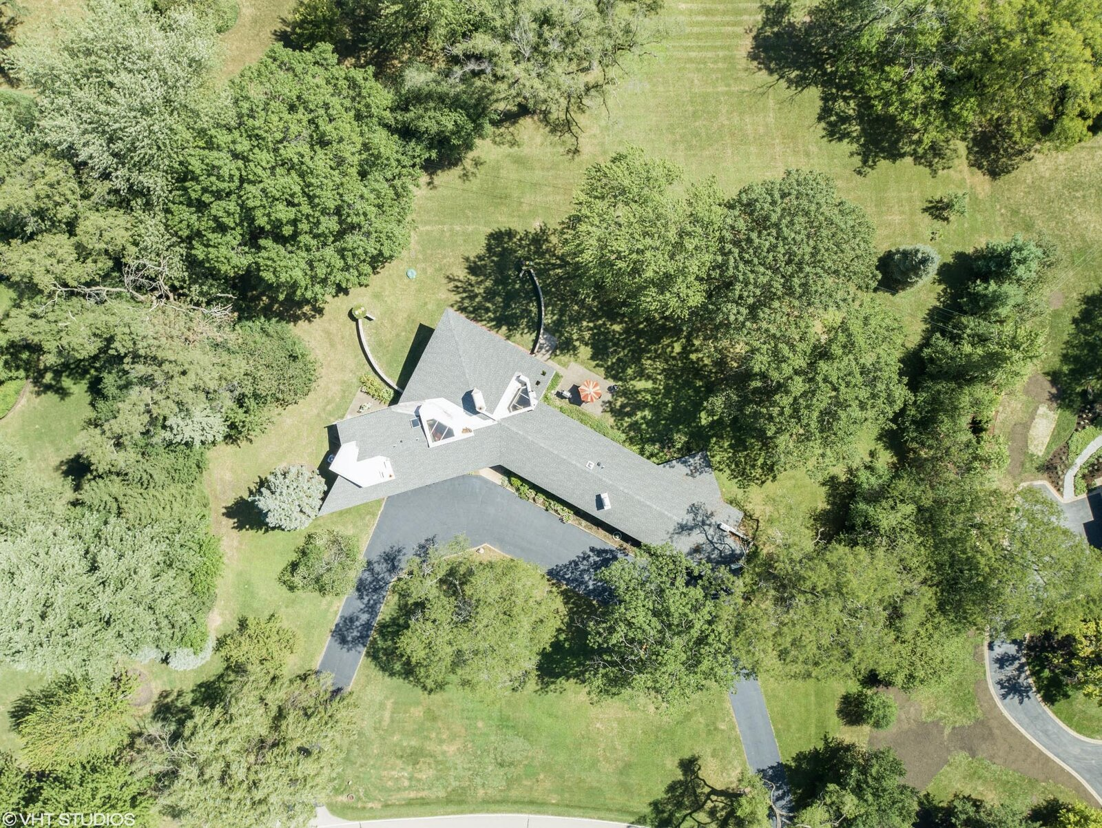 An aerial view of the property shows its placement on the 1.63-acre lot.  Photo 14 of 14 in A Big and Bright Midcentury Home by Frank Lloyd Wright Apprentice Don Erickson Asks $595K