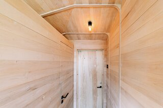 A hallway provides access to the bathroom (along the left-hand side), as well as the main entrance straight ahead.