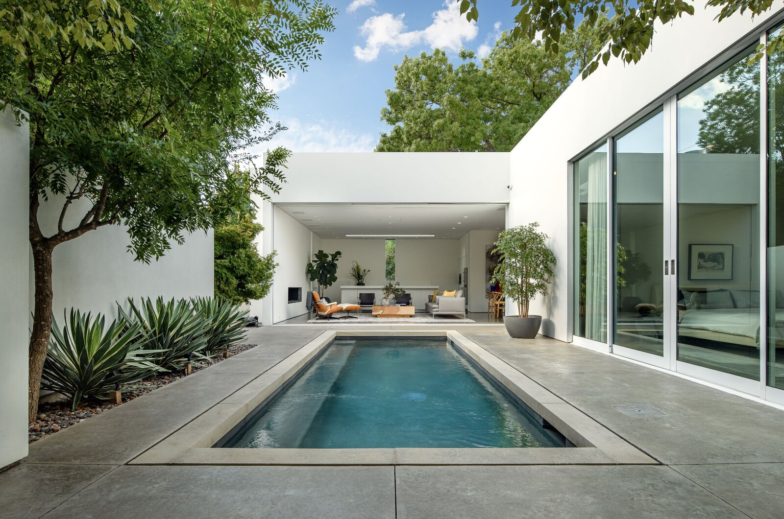 Outside, the enclosed patio and inviting pool provide a private urban oasis for new buyers.