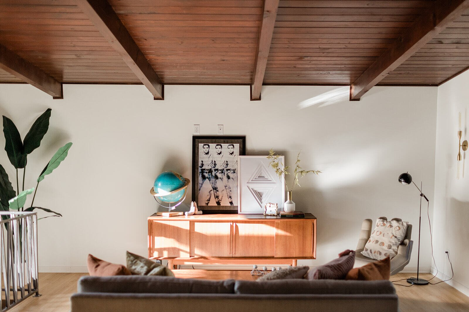 The renovation also retained the  home's original wood-clad and beamed ceilings found throughout the interior.  Photo 10 of 21 in Before & After: A Renovated Iowan Midcentury House Impresses With an Affordable $330K Price Point