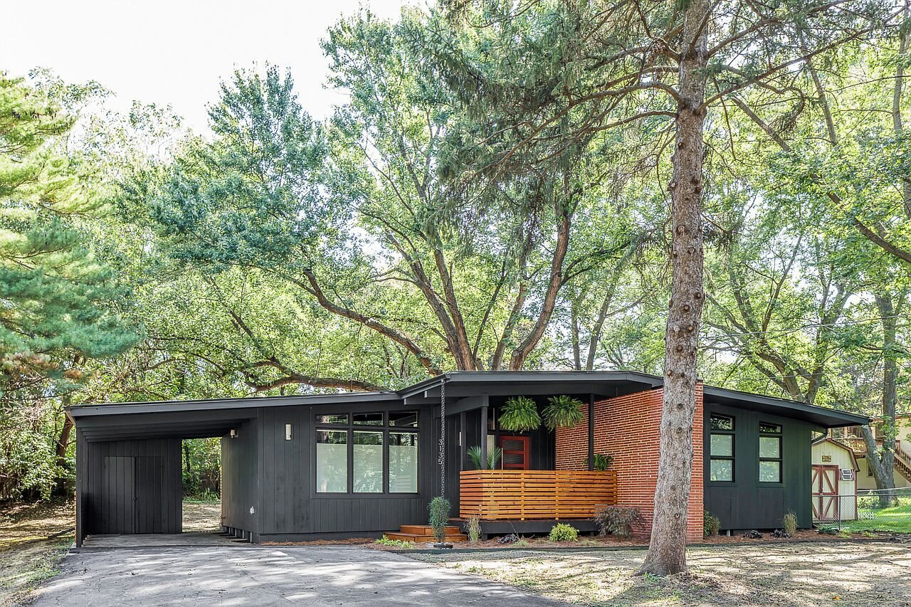 After, the exterior is painted Regent Green by Benjamin Moore.  Photo 3 of 21 in Before & After: A Renovated Iowan Midcentury House Impresses With an Affordable $330K Price Point