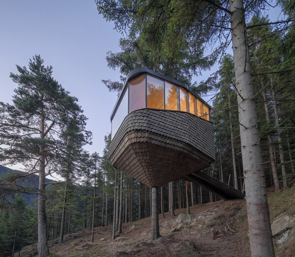 Helen & Hard built a pair of pine cone–shaped cabins that wrap around tree trunks in the forests of Odda, Norway.