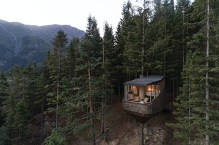 Wrapped in glass on three sides, the Woodnest tree houses offer panoramic views of the surroundings mountains and fjord.