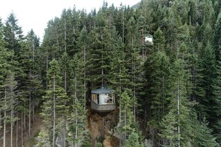 Designed by Helen & Hard Architects, Woodnest is a pair of rentable dwellings suspended from living trees in Odda, Norway.