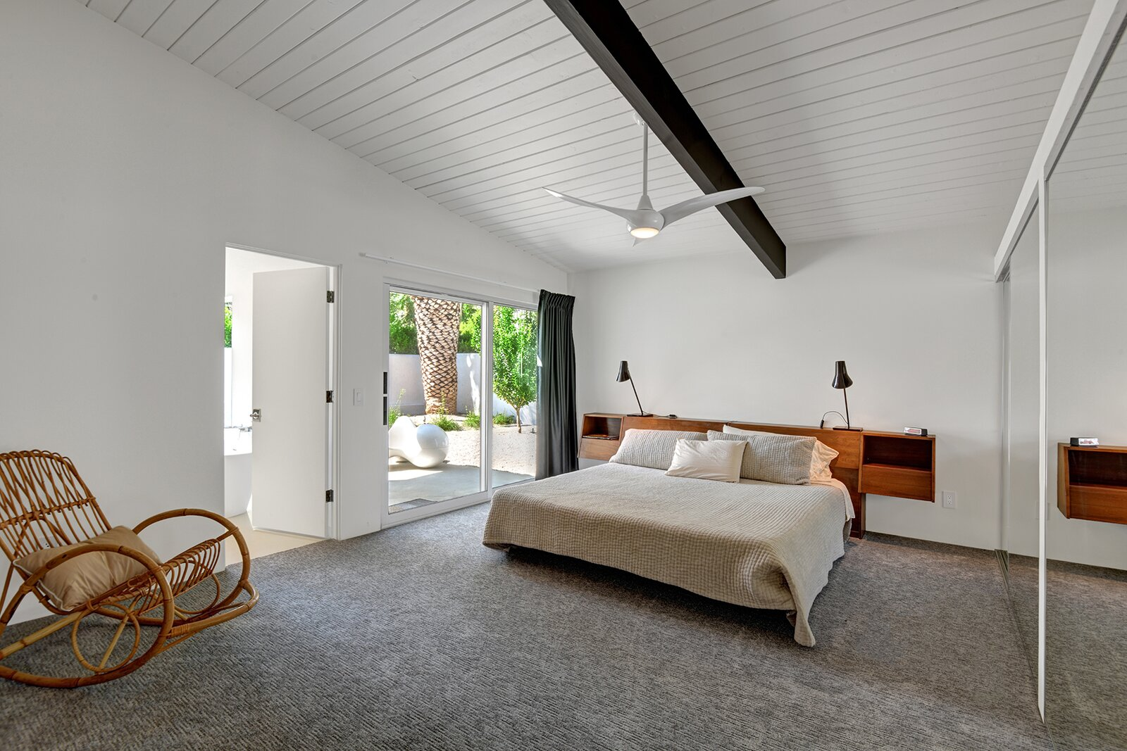 Back inside, the principal bedroom suite provides direct access to a private patio.  Photo 12 of 17 in A Palm Springs Alexander Home Sings After a Chic Renovation and Hits the Market to the Tune of $2.1M